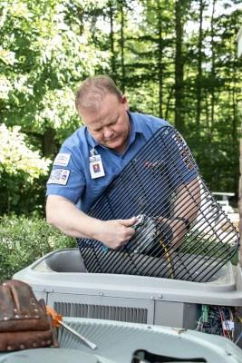 Scott working with an HVAC fan.