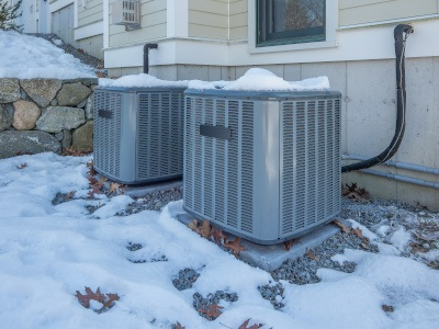 HVAC units with snow on them.